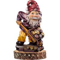 Gnome gold-digger on pedestal