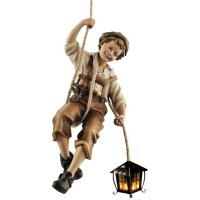 Boy rappeling with lantern